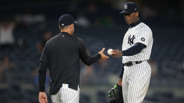New York Yankees closer Aroldis Chapman, manager Aaron Boone