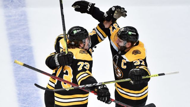 Boston Bruins defenseman Charlie McAvoy and center Patrice Bergeron