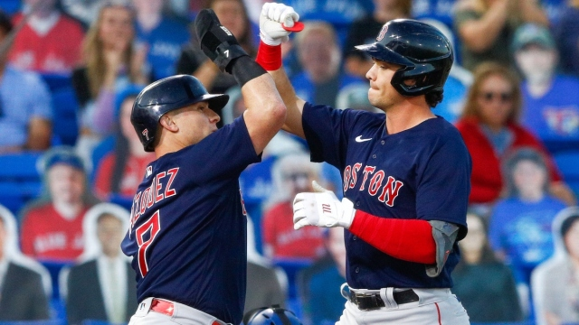 Boston Red Sox catcher Christian Vázquez (left) and first baseman Bobby Dalbec