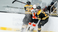 Boston Bruins defenseman Connor Clifton, forward Nick Ritchie, Philadelphia Flyers forward Travis Konecny