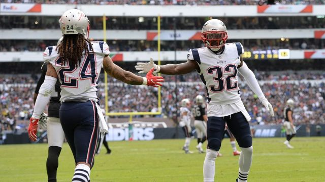 Patriots defensive backs Stephon Gilmore and Devin McCourty