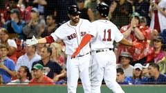 Boston Red Sox third baseman Rafael Devers, designated hitter J.D. Martinez
