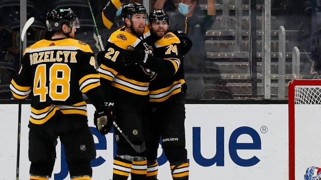 Boston Bruins wingers Jake DeBrusk and Nick Ritchie, defenseman Matt Grzlecyk