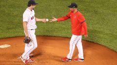 Boston Red Sox reliever Josh Taylor, Manager Alex Cora