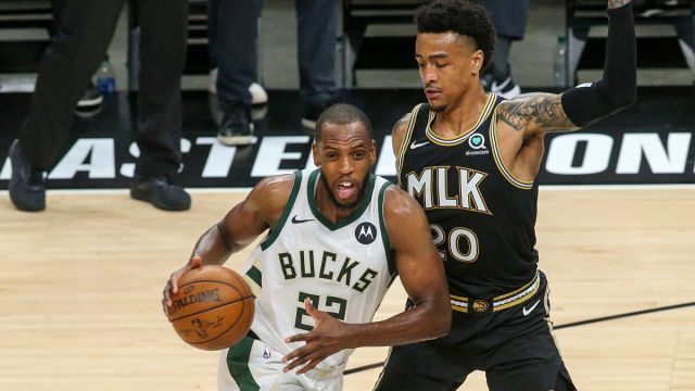 Milwaukee Bucks forward Khris Middleton and Atlanta Hawks forward John Collins