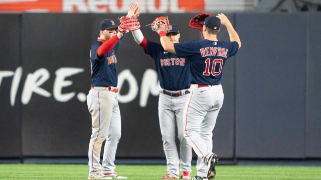 Boston Red Sox outfielders Kiké Hernandez, Alex Verdugo, Hunter Renfroe