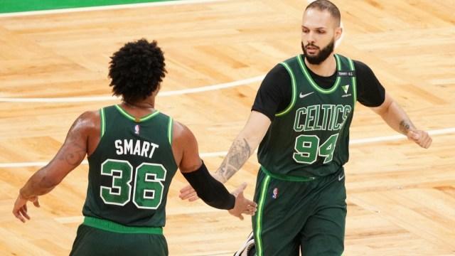 Boston Celtics guard Marcus Smart (left) and free agent forward Evan Fournier