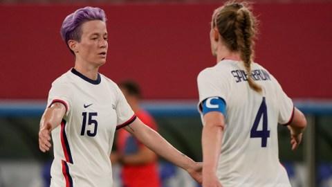 United States forward Megan Rapinoe (15) and defender Becky Sauerbrunn (4)