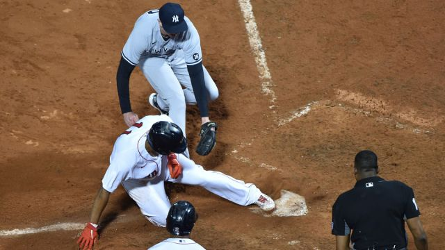 Boston Red Sox third baseman Rafael Devers and New York Yankees pitcher Brooks Kriske