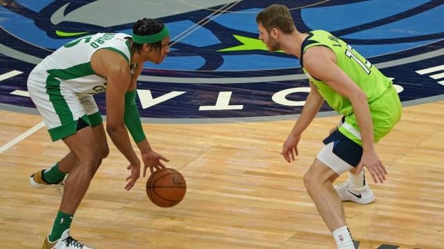 Boston Celtics guard Romeo Langford (45) and Minnesota Timberwolves forward Jake Layman (10)