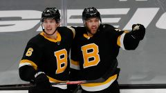 Boston Bruins' Taylor Hall and Mike Reilly