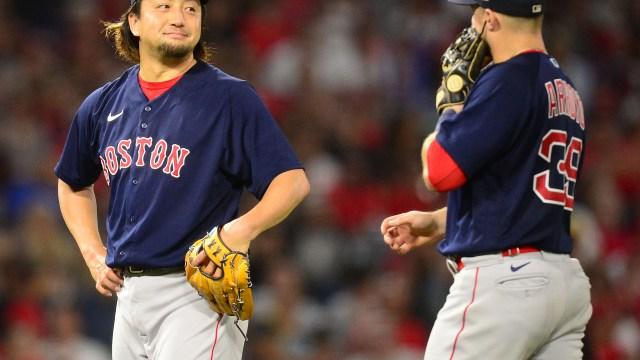 Boston Red Sox infielder Christian Arroyo and pitcher Hirokazu Sawamura