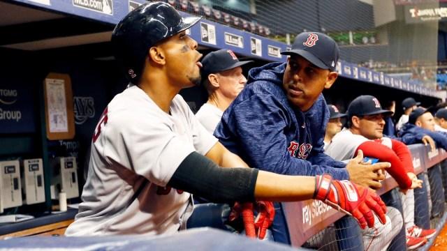 Boston Red Sox shortstop Xander Bogaerts, manager Alex Cora