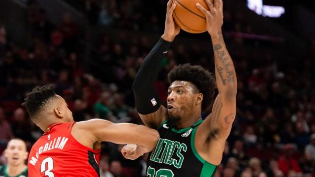 Boston Celtics guard Marcus Smart, Portland Trail Blazers guard CJ McCollum