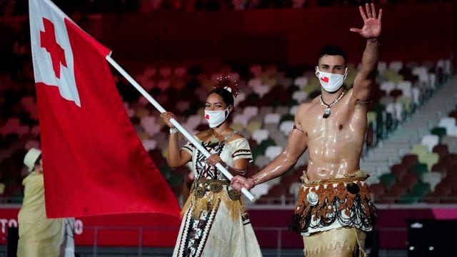 Tonga flag bearers Malia Paseka and Pita Taufatofua