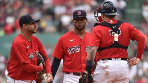 Boston Red Sox shortstop Xander Bogaerts (2) catcher Christian Vazquez (7) speak with starting pitcher Martin Perez