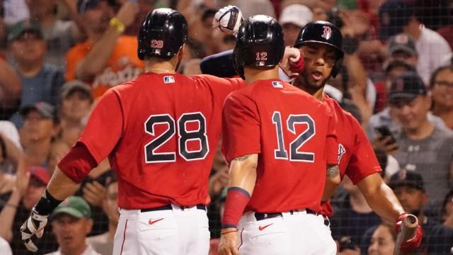 Boston Red Sox left fielder J.D. Martinez, Marwin Gonzalez, Xander Bogaerts