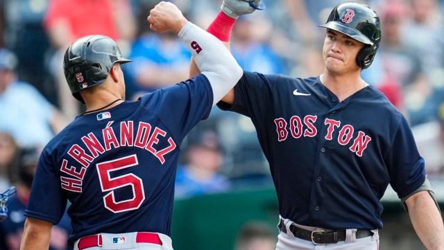 Boston Red Sox center fielder Kiké Hernández (left) and first baseman Bobby Dalbec