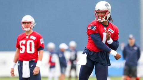 New England Patriots quarterbacks Cam Newton (1) and Mac Jones (50)