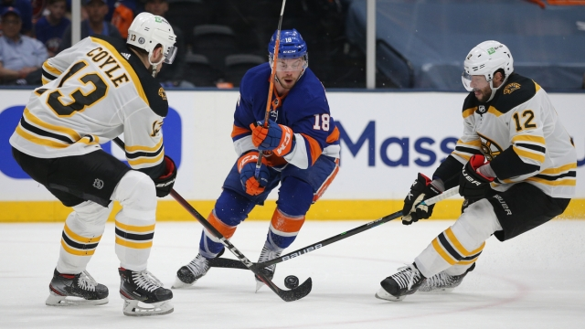 Boston Bruins forwards Charlie Coyle, Craig Smith, New York Islanders forward Anthony Beauvillier