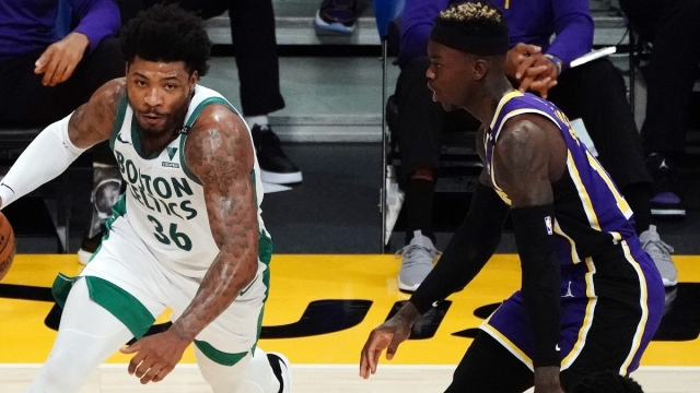 Boston Celtics guard Marcus Smart (36) and NBA guard Dennis Schroder (17)