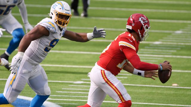 Los Angeles Chargers defensive tackle Jerry Tillery and Kansas City Chiefs quarterback Patrick Mahomes