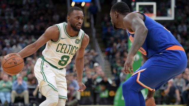 NBA guard Kemba Walker (8) and New York Knicks center Julius Randle (30)