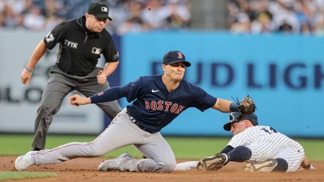 Boston Red Sox second baseman Kiké Hernández (left) and New York Yankees left fielder Brett Gardner