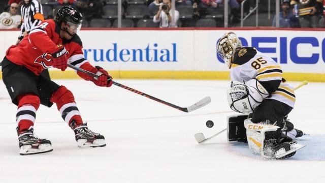 Boston Bruins goalie Kyle Keyser, New Jersey Devils winger Miles Wood