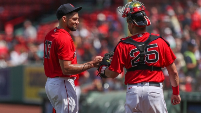Boston Red Sox starting pitcher Nathan Eovaldi (17) and catcher Kevin Plawecki (25)