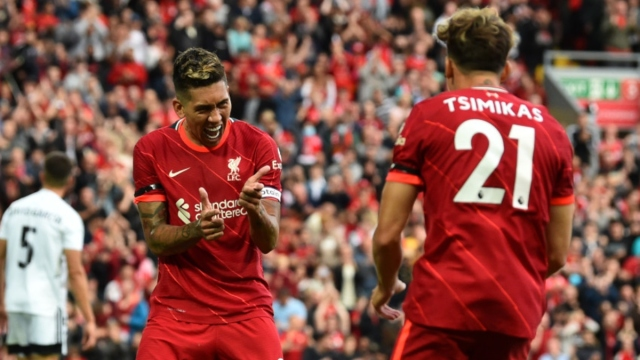 Liverpool forward Roberto Firmino (left) and defender Kostas Tsimikas