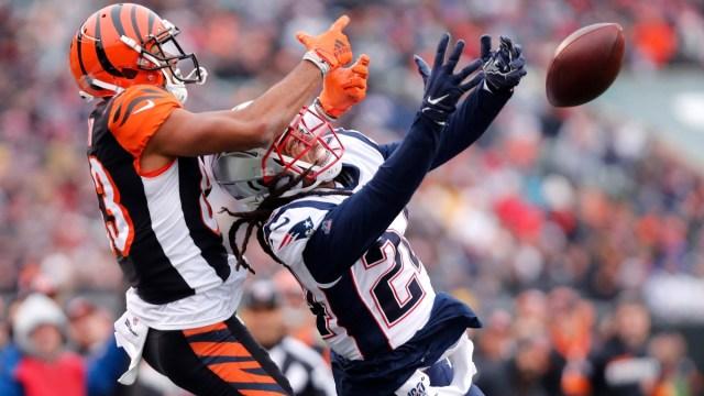 New England Patriots cornerback Stephon Gilmore (24) and Cincinnati Bengals wide receiver Tyler Boyd (83)