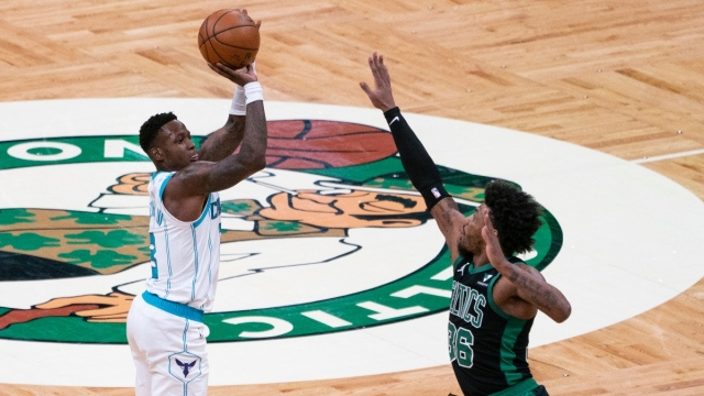 Charlotte Hornets shooting guard Terry Rozier (3) and Boston Celtics point guard Marcus Smart (36)