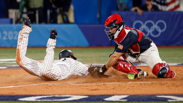 Team Japan infielder Tetsuto Yamada, United States catcher Mark Kolozsvary