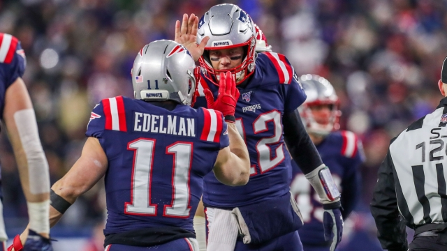 Tampa Bay Buccaneers quarterback Tom Brady, former New England Patriots wide receiver Julian Edelman
