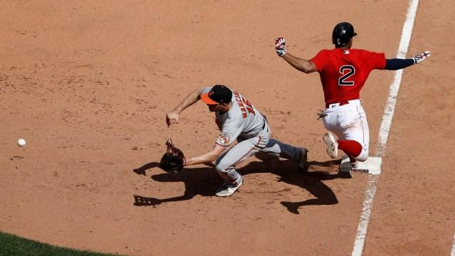 Boston Red Sox shortstop Xander Bogaerts (2) and Baltimore Orioles first baseman Trey Mancini (16)