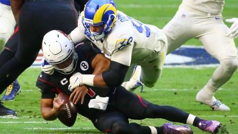 Los Angeles Rams defensive end Aaron Donald (99) and Arizona Cardinals quarterback Kyler Murray (1)