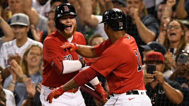 Boston Red Sox third baseman Rafael Devers (11) and left fielder Alex Verdugo (99)