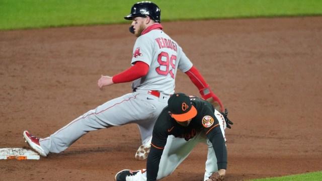 Boston Red Sox outfielder Alex Verdugo (99) and Baltimore Orioles second baseman Ramon Urias