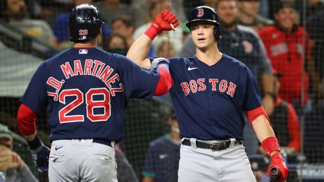 Boston Red Sox first baseman Bobby Dalbec, designated hitter J.D. Martinez