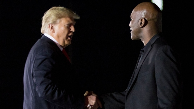 Former U.S. president Donald Trump and boxer Evander Holyfield (right)