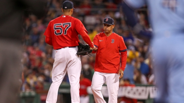 Boston Red Sox pitcher Eduardo Rodriguez and manager Alex Cora (left)