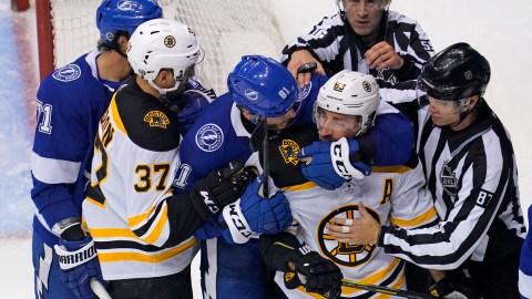 Boston Bruins forwards Patrice Bergeron and Brad Marchand, Tampa Bay Lightning center Anthony Cirelli and defenseman Erik Cernak