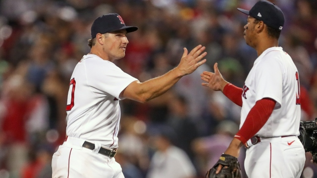 Boston Red Sox right fielder Hunter Renfroe (10) and third baseman Rafael Devers (11)