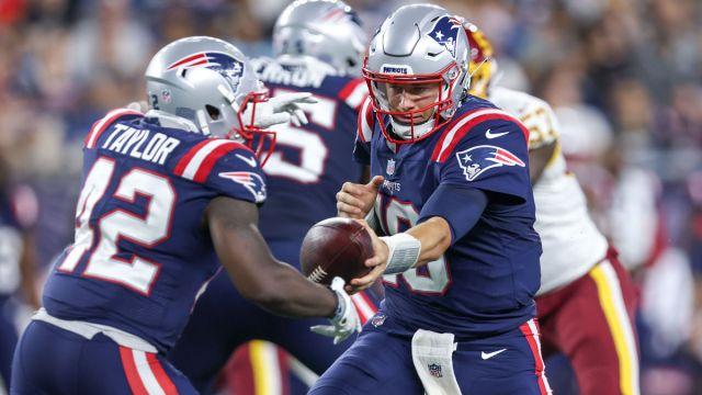 New England Patriots running back J.J. Taylor and quarterback Mac Jones
