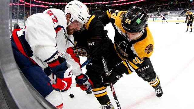 Boston Bruins defenseman Jack Ahcan, Washington Capitals forward Evgeny Kuznetsov