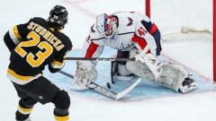 Boston Bruins center Jack Studnicka, Washington Capitals goalie Vitek Vanecek
