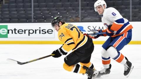 Boston Bruins winger Jake DeBrusk, New York Islanders defenseman Ryan Pulock