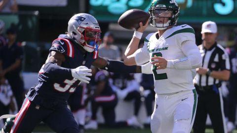 New England Patriots defensive back Joejuan Williams and New York Jets quarterback Zach Wilson