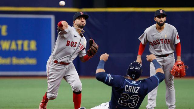 Boston Red Sox infielder Jonathan Araúz and Tampa Bay Rays designated hitter Nelson Cruz